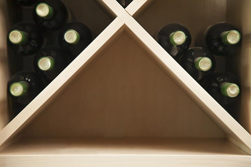 Bottles of white wine on a wine rack